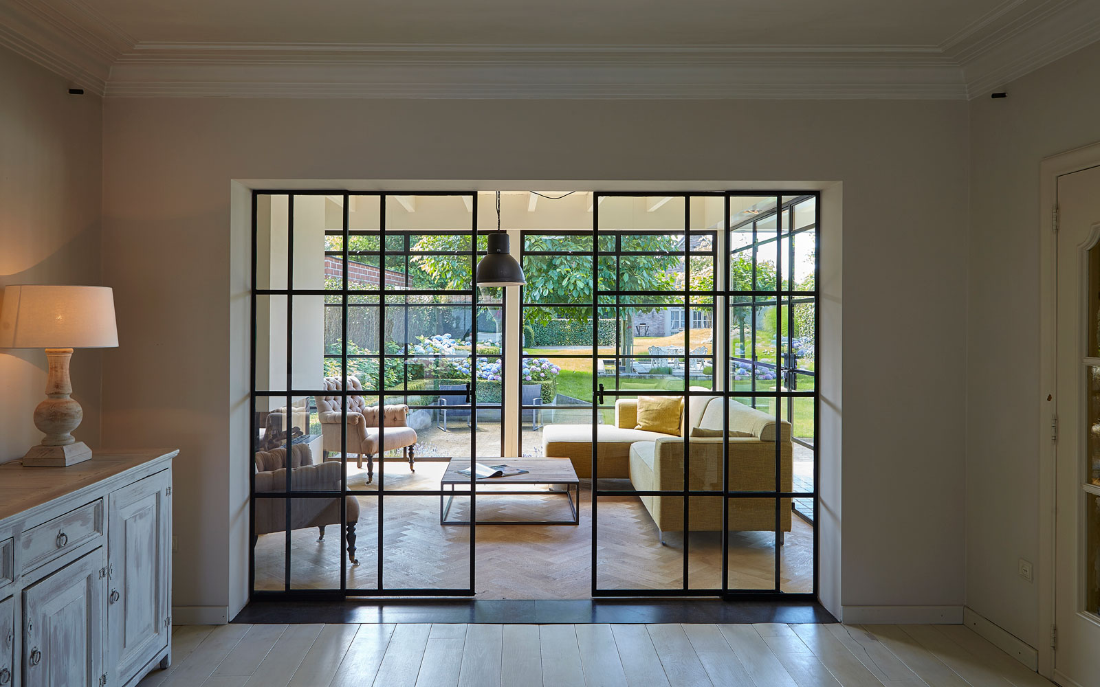 Overgang van binnen naar buiten, woonkamer, tuinkamer, stalen deuren, Stalen Deuren Huys, Kijkwoning