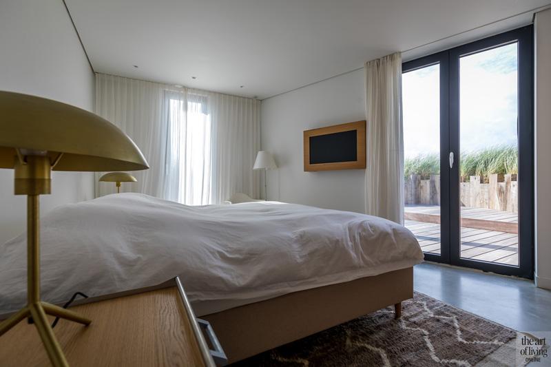 Slaapkamer met zicht op de duinen