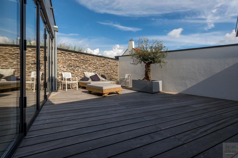 Terras, lounge, muur The Flagstone Company, tuinmeubelen Dokter Interieurbouw