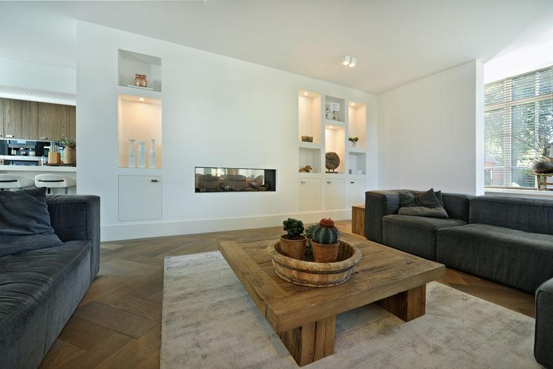 Woonkamer, doorkijkhaard, kusk, houten vloer, metamorfose, Boxxis Architecten