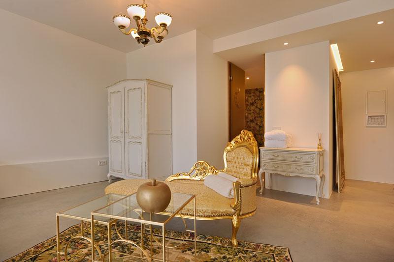 Gouden kamer, loungestoel, goud, La Marquise, Hertroijs Architekten