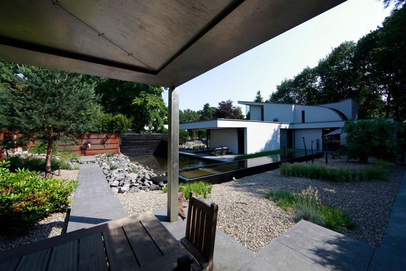 Tuin, parktuin, overkapping, terras, kleurrijk, Van Esch Hoveniers, moderne villa, Boley