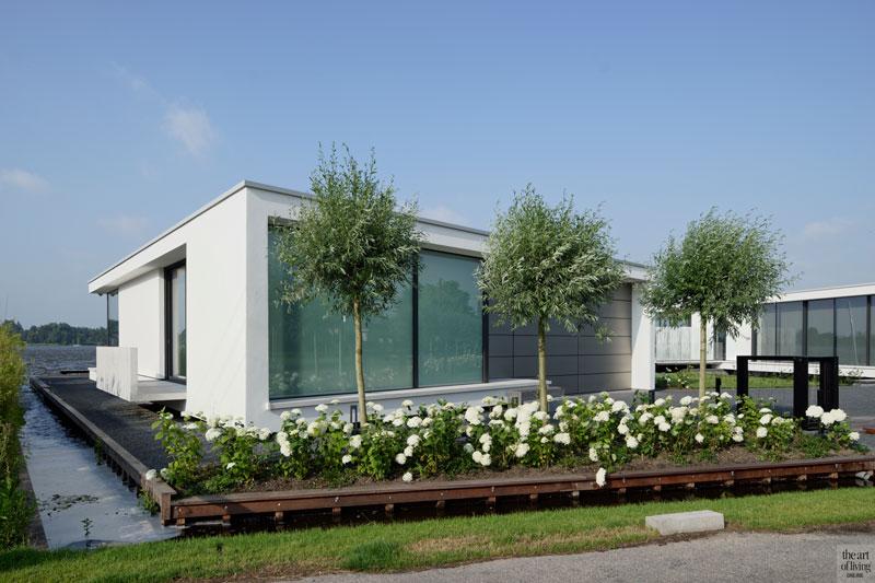 Strak stucwerk, Van Ballegooijen, villa aan het water, Lab32 architecten