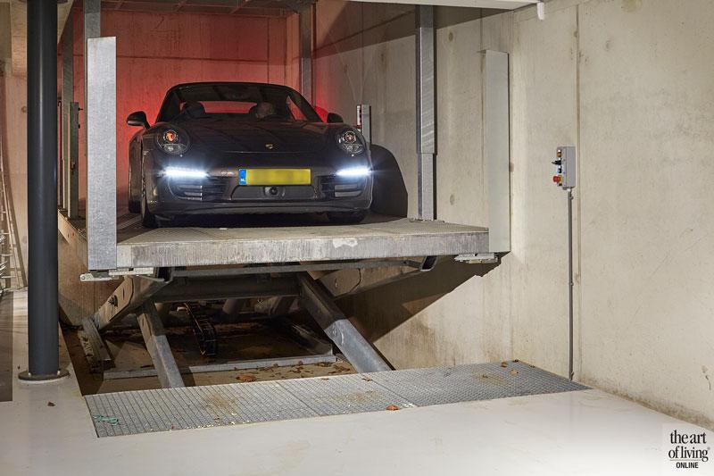 Kelder, garage, auto, parkeerplaats, autolift, MP liften, modern en eigentijds, De Bever Architecten