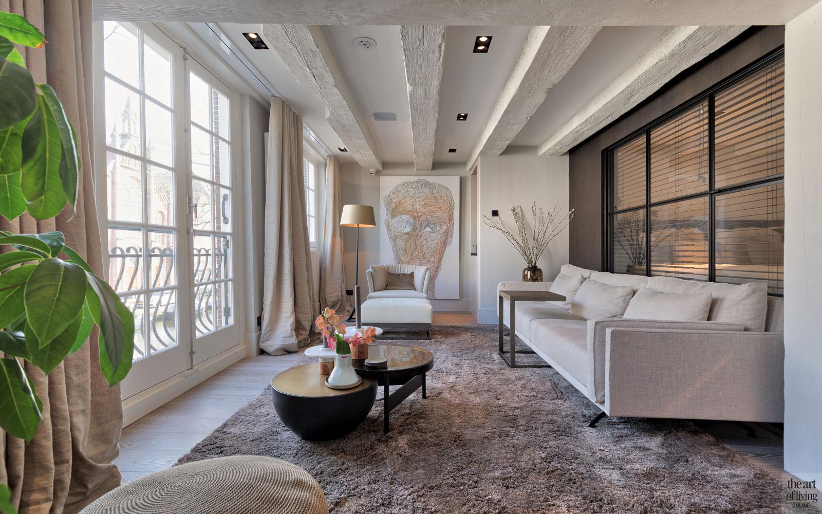 Woonkamer, living, grote ramen, lichtinval, Marcel Wolterinck, kunst, sfeervolle lift, Studio Vendrig