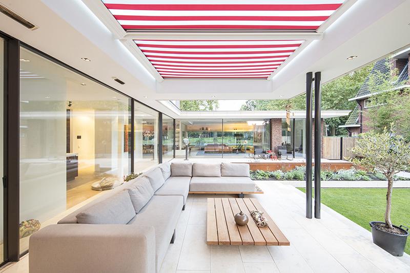 Sfeervolle tuin, De Bever Architecten, Veranda, Lounge