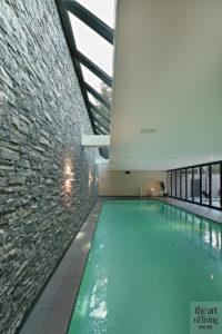 Nieuwbouw villa, Strategie Architecten, Wellness, Binnenzwembad, Bakstenen muur, Mozaïek, Solarlux vouwwand, Schuifpui, grote ramen, dakraam, souterain, kelder, Sauna, Infrarood sauna